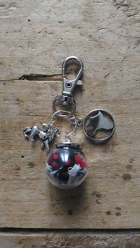 Porte clés fiole wax carte afrique et lion