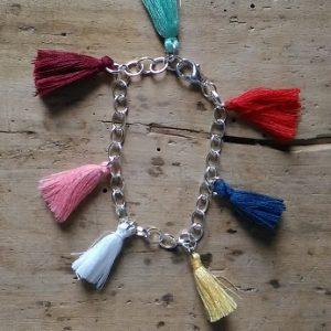 Bracelet souple argent pompons multicolores