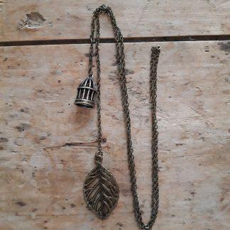 Collier à nouer feuille et cage bronze