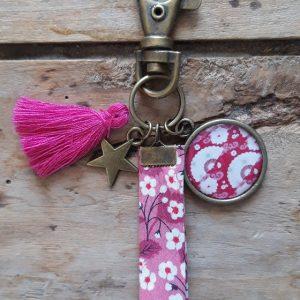 Porte-clés bronze eventails ton rose-blanc