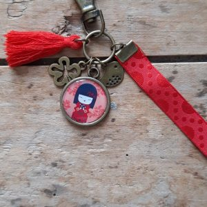 Porte clés bronze Kokeshi Rouge